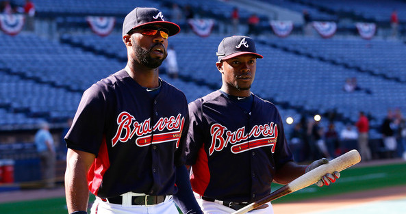 Heyward and the good Upton. (Kevin C. Cox/Getty)