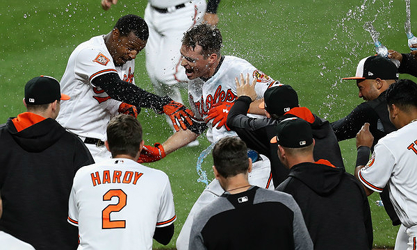 Trey Mancini after a walk-off (Rob Carr/Getty Images North America)