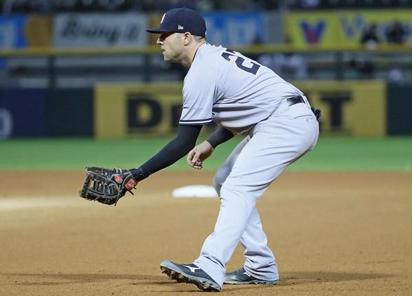 Catcher at first base. (Jonathan Daniel/Getty)
